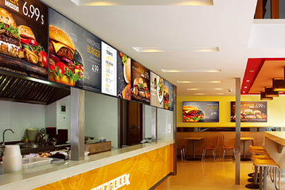 Integrated digital signage delivering compelling images and information at QSRs